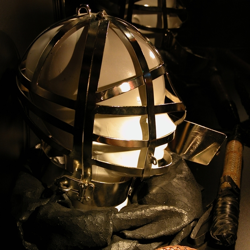A shining head cage on a mannequins head at the erotic museum.