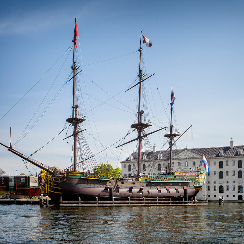 The replica of VOC ship the Amsterdam with in the background the National Maritime Museum.