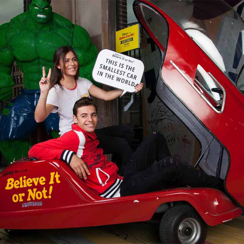 Smallest car in the world at Ripleys Believe It or Not! Amsterdam with guy and girl in it