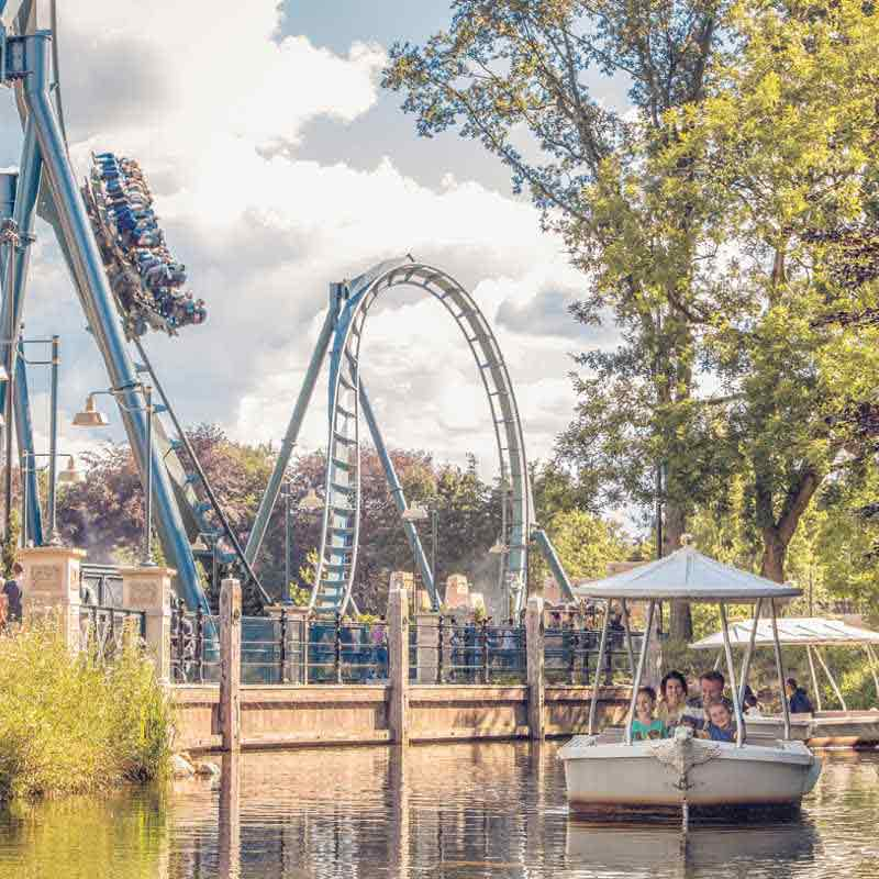 Rollercoaster at the Efteling with family boats on the water in front