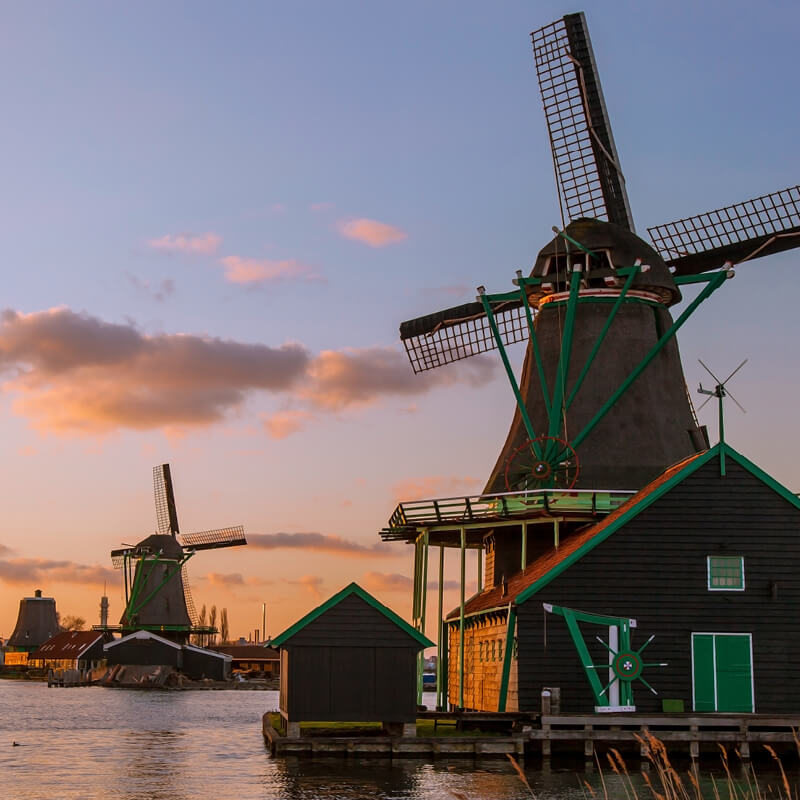 Windmills on the waterside at the Zaanse Schans.