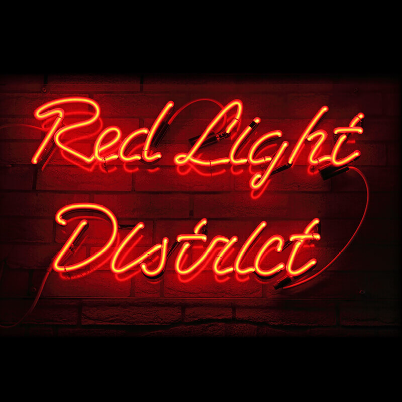 Neon sign that reads Red Light District.