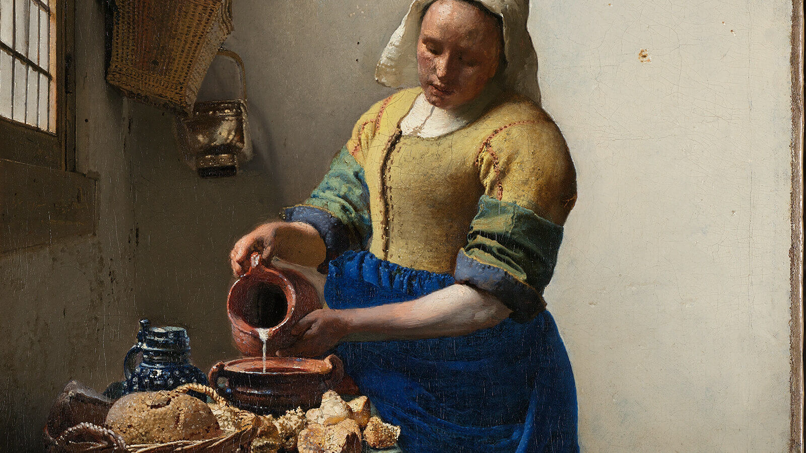 Up-close view of painting 'The Milkmaid' by Johannes Vermeer.