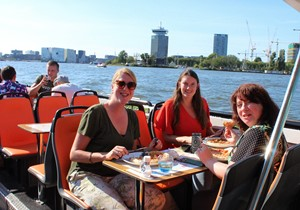 Is this the right time for an Amsterdam canal cruise with New York Pizza?