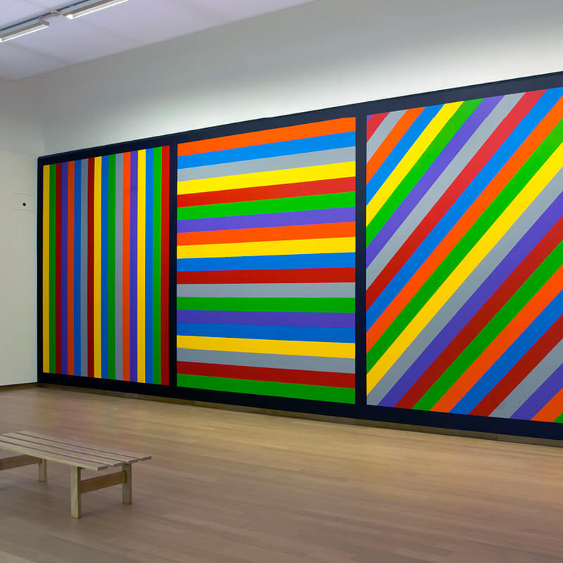 A painting with bright colored stripes at the Stedelijk Museum in Amsterdam.