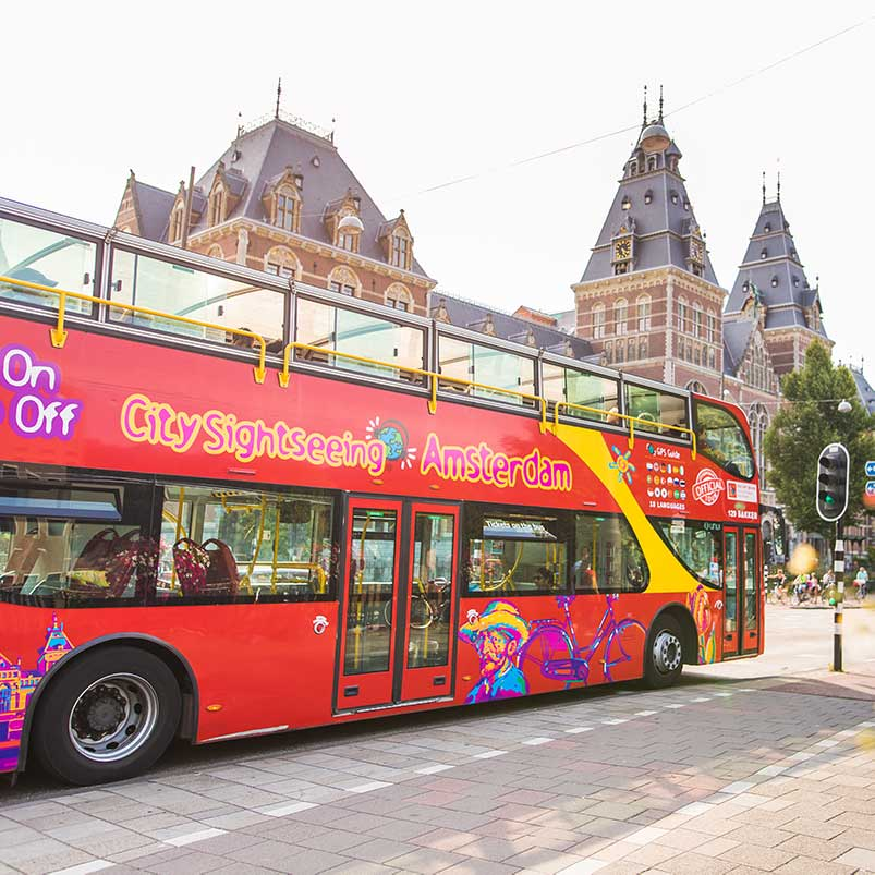 Hop on Hop off bus from City Sightseeing Amsterdam on the road next to the Rijksmuseum.
