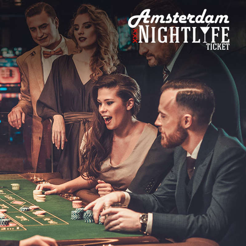 People with an Amsterdam Nightlife Ticket sitting at a roulette table at the Holland Casino Amsterdam.