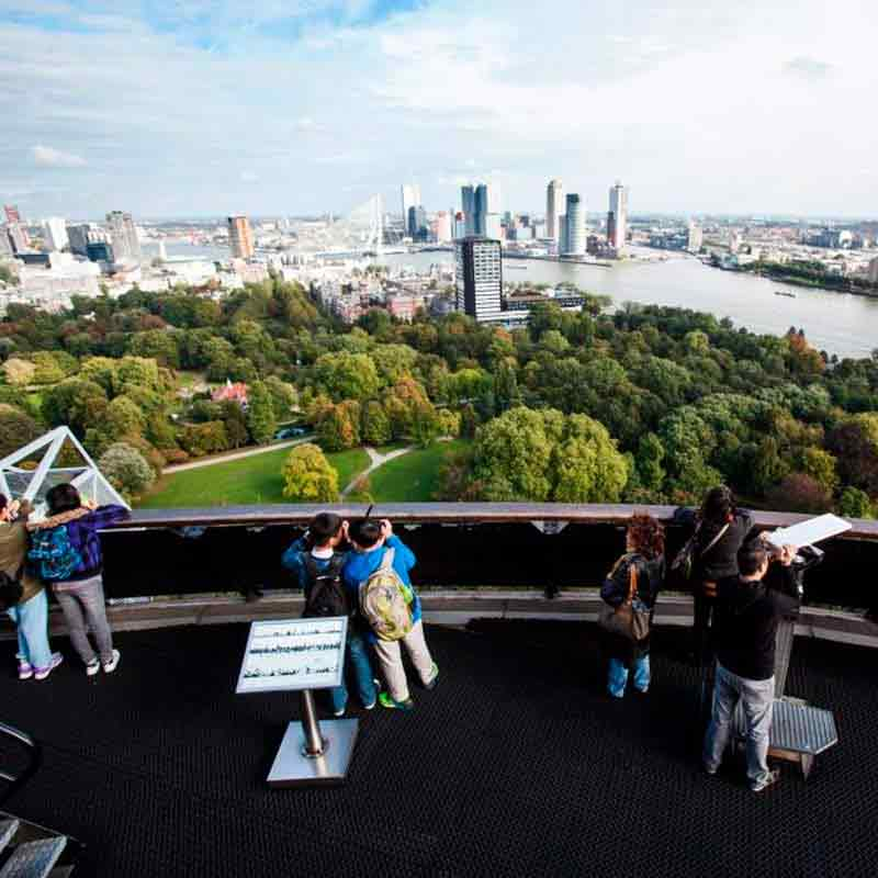 People standing on the viewing deck of the Euromast with a view of Rotterdam